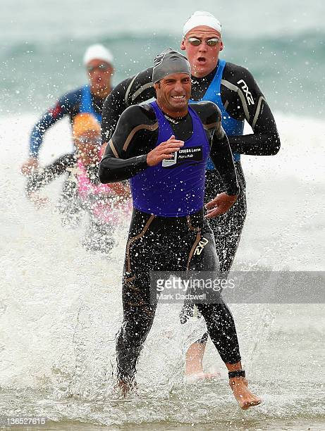 Tristan Read runs out of the water in the Open Male section of the 2012 Pier to Pub on January 7 2012 in Lorne Australia