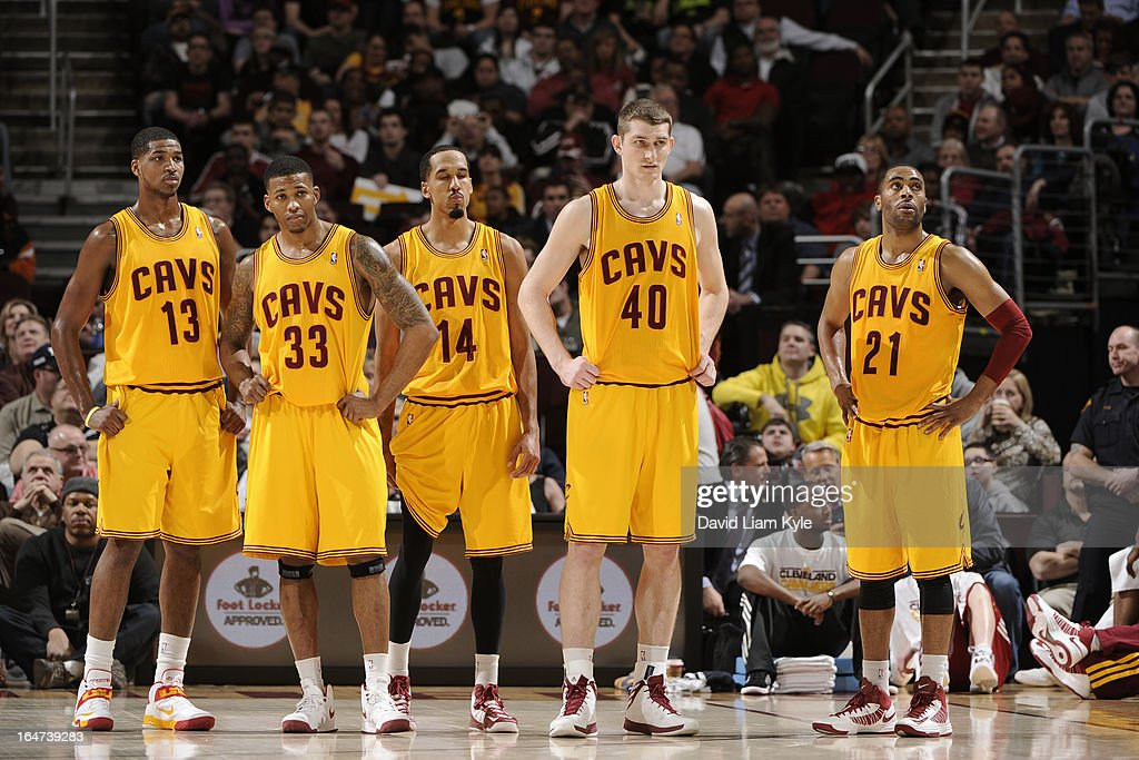 Tristan Thompson #13, Alonzo Gee #33, Shaun Livingston #14, Tyler Zeller #40 and Wayne Ellington #21 of the Cleveland Cavaliers stand on the court during the game against the Miami Heat at The Quicken Loans Arena on March 20, 2013 in Cleveland, Ohio.
