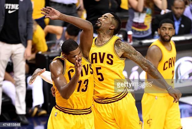 Tristan Thompson and JR Smith of the Cleveland Cavaliers react after a dunk by Thompson in the third quarter against the Atlanta Hawks during Game...