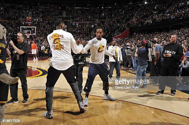 Tristan Thompson and JR Smith of the Cleveland Cavaliers shake hands before the game against the New York Knicks on October 25 2016 at Quicken Loans...