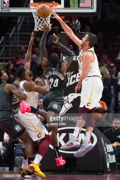 Tristan Thompson and Kevin Love of the Cleveland Cavaliers block Rondae HollisJefferson of the Brooklyn Nets during the first half at Quicken Loans...