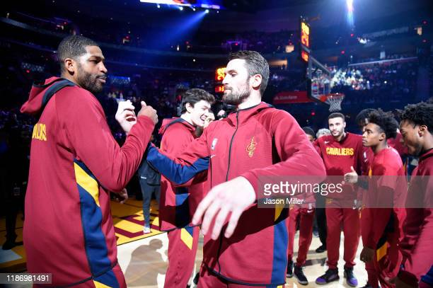 Tristan Thompson and Kevin Love of the Cleveland Cavaliers celebrate during player introductions prior to the game against the Dallas Mavericks at...