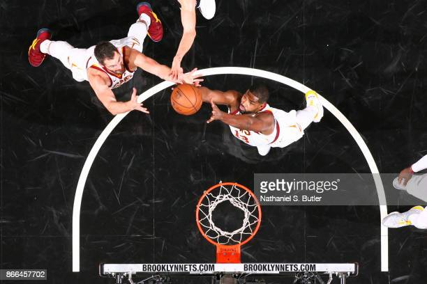 Tristan Thompson and Kevin Love of the Cleveland Cavaliers jump for the rebound on October 25 2017 at Barclays Center in Brooklyn New York NOTE TO...