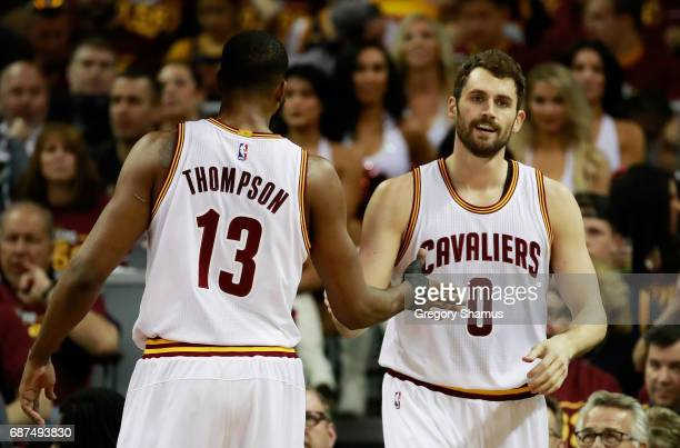 Tristan Thompson and Kevin Love of the Cleveland Cavaliers react in the first half against the Boston Celtics during Game Four of the 2017 NBA...