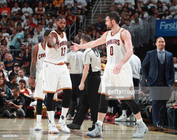 Tristan Thompson and Kevin Love of the Cleveland Cavaliers react to a play during a game against the Indiana Pacers in Round One of the Eastern...
