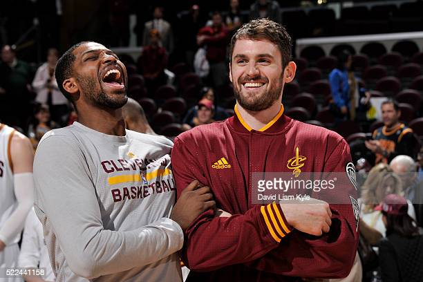 Tristan Thompson and Kevin Love of the Cleveland Cavaliers smile before the game against the Detroit Pistons on April 13, 2016 at Quicken Loans Arena...