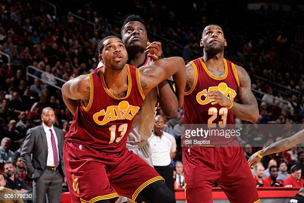 Tristan Thompson and LeBron James of the Cleveland Cavaliers defend the basket against Clint Capela of the Houston Rockets during the game on January...