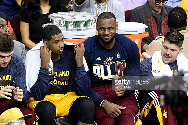 Tristan Thompson and LeBron James of the Cleveland Cavaliers look on from the bench late in the second half against the Atlanta Hawks during Game...
