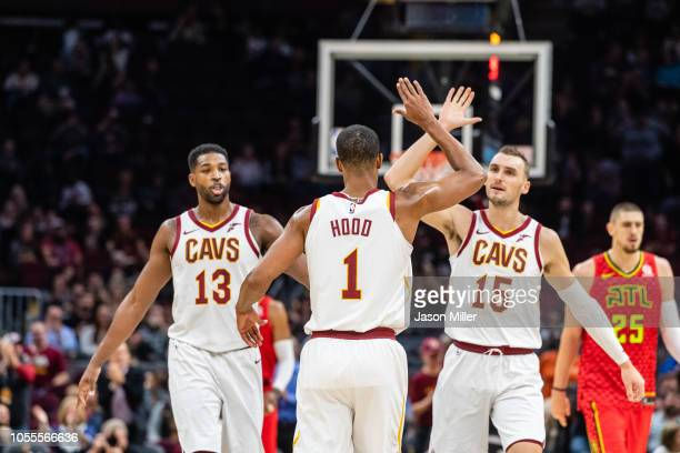 Tristan Thompson and Sam Dekker celebrate with Rodney Hood of the Cleveland Cavaliers during the first half against the Atlanta Hawks at Quicken...