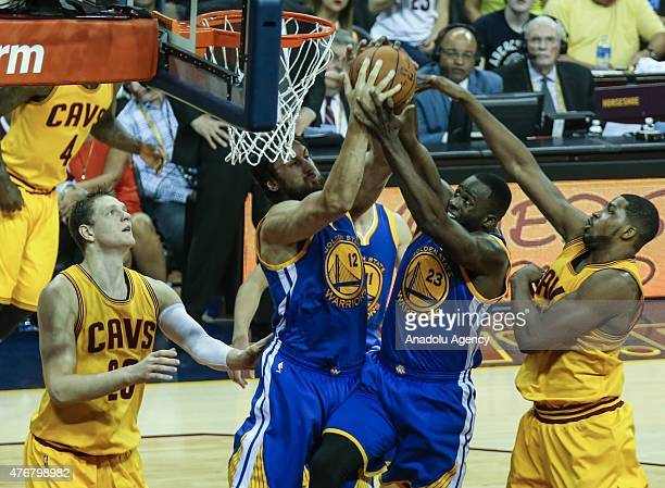 Tristan Thompson and Timofey Mozgov of the Cleveland Cavaliers vie against Andrew Bogut and Draymond Green of the Golden State Warriors during Game...
