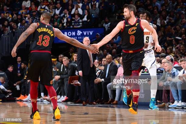 Tristan Thompson high fives teammate Kevin Love of the Cleveland Cavaliers during the game against the Denver Nuggets on January 11 2020 at the Pepsi...