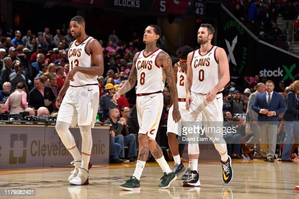 Tristan Thompson Jordan Clarkson and Kevin Love of the Cleveland Cavaliers walk on the court against the Chicago Bulls on October 30 2019 at Rocket...