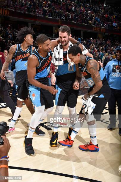 Tristan Thompson Kevin Love and Jordan Clarkson of the Cleveland Cavaliers hug after a game against the Memphis Grizzlies on December 20 2019 at...