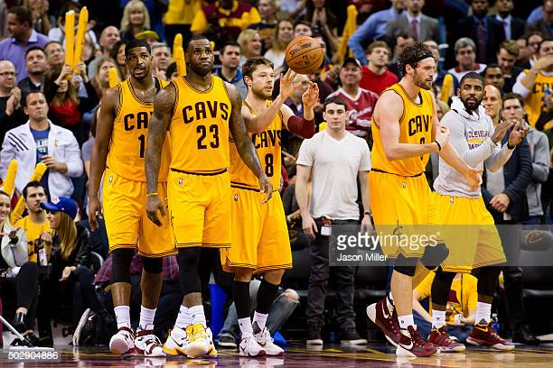 Tristan Thompson LeBron James Matthew Dellavedova Kevin Love and Kyrie Irving of the Cleveland Cavaliers walk on the court during the second half...