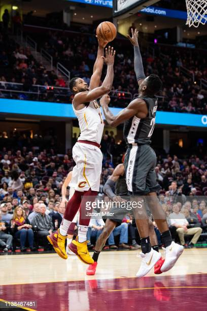 Tristan Thompson of the Cleveland Cavaliers and Caris LeVert of the Brooklyn Nets fight for a rebound during the first half at Quicken Loans Arena on...