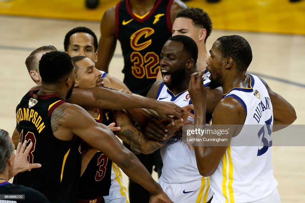 Tristan Thompson #13 of the Cleveland Cavaliers and Draymond Green #23 of the Golden State Warriors exchange words in overtime during Game 1 of the 2018 NBA Finals at ORACLE Arena on May 31, 2018 in Oakland, California.