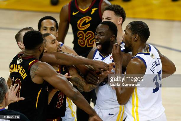 Tristan Thompson of the Cleveland Cavaliers and Draymond Green of the Golden State Warriors exchange words in overtime during Game 1 of the 2018 NBA...