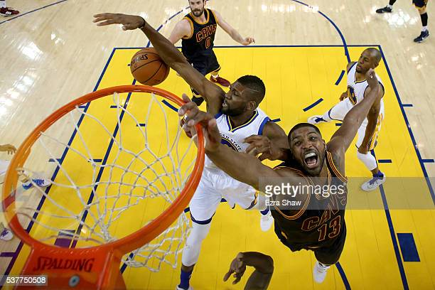 Tristan Thompson of the Cleveland Cavaliers and Festus Ezeli of the Golden State Warriors battle for the ball in the second half in Game 1 of the...