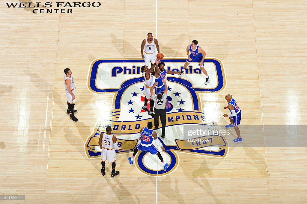Tristan Thompson #13 of the Cleveland Cavaliers and Joel Embiid #21 of the Philadelphia 76ers go up for the opening tip off at the Wells Fargo Center on November 5, 2016 in Philadelphia, Pennsylvania.