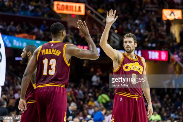 Tristan Thompson of the Cleveland Cavaliers and Kevin Love celebrate after scoring during the second half against the Toronto Raptors at Quicken...