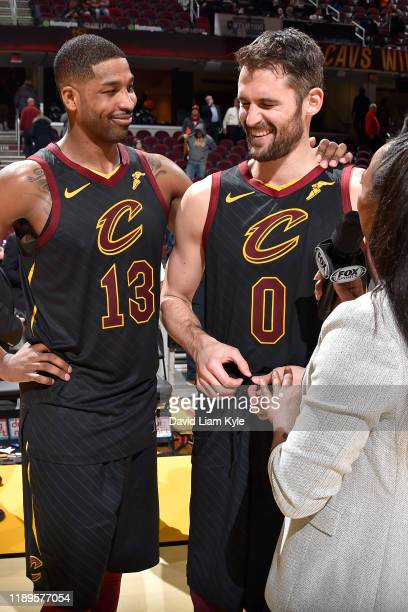 Tristan Thompson of the Cleveland Cavaliers and Kevin Love of the Cleveland Cavaliers talks with the media after the game against the Charlotte...