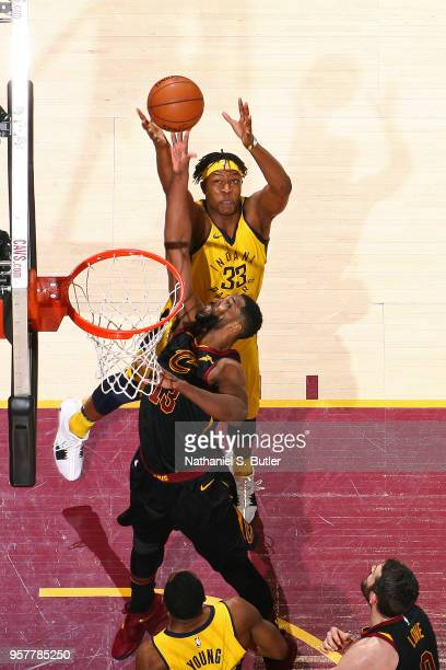 Tristan Thompson of the Cleveland Cavaliers and Myles Turner of the Indiana Pacers reach for the ball in Game Seven of Round One of the 2018 NBA...