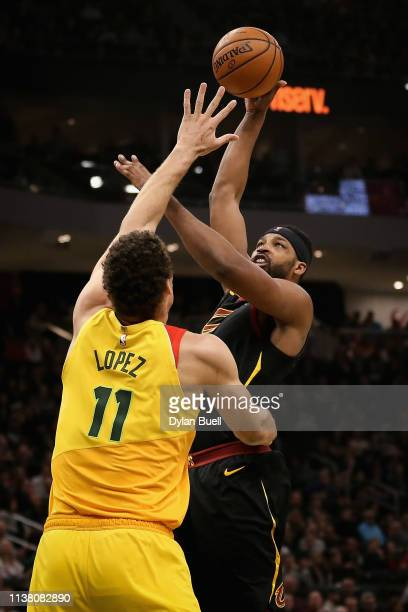 Tristan Thompson of the Cleveland Cavaliers attempts a shot while being guarded by Brook Lopez of the Milwaukee Bucks in the second quarter at the...