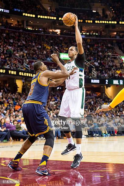 Tristan Thompson of the Cleveland Cavaliers attempts to block John Henson of the Milwaukee Bucks during the first half at Quicken Loans Arena on...