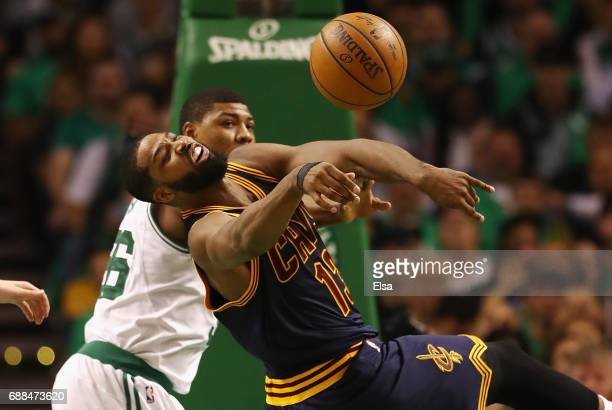 Tristan Thompson of the Cleveland Cavaliers battles for the ball with Marcus Smart of the Boston Celtics in the first half during Game Five of the...