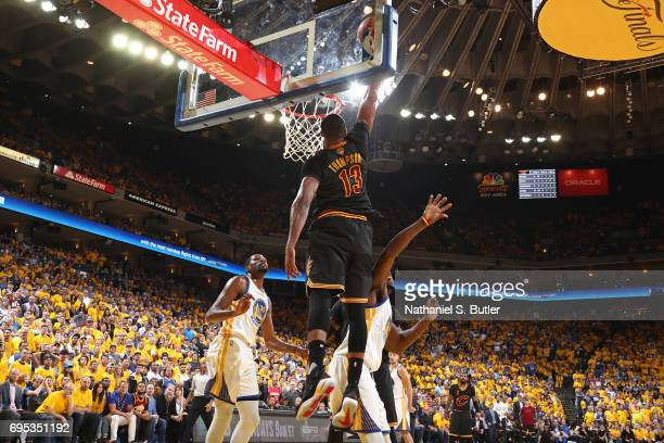 Tristan Thompson of the Cleveland Cavaliers catches the pass and dunks the ball against the Golden State Warriors in Game Five of the 2017 NBA Finals...