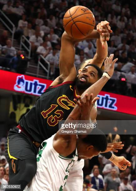 Tristan Thompson of the Cleveland Cavaliers competes for the ball against Marcus Smart and Jayson Tatum of the Boston Celtics in the second quarter...