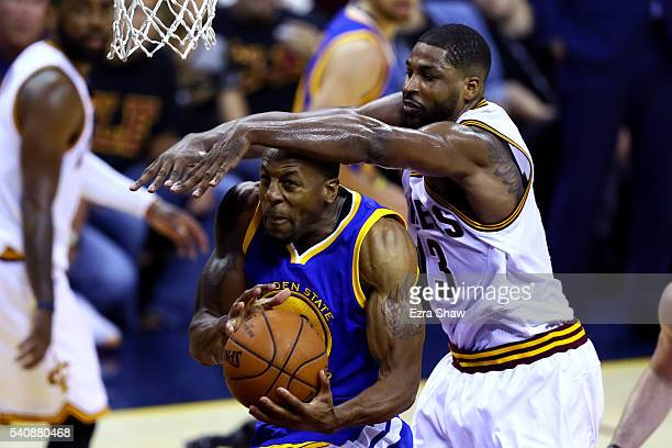 Tristan Thompson of the Cleveland Cavaliers defends Andre Iguodala of the Golden State Warriors in the second half in Game 6 of the 2016 NBA Finals...