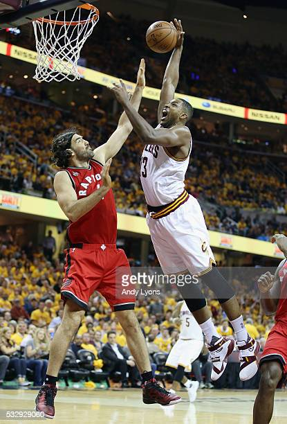Tristan Thompson of the Cleveland Cavaliers drives to the basket against Luis Scola of the Toronto Raptors during the second half in game two of the...