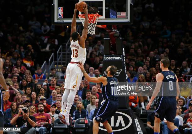 Tristan Thompson of the Cleveland Cavaliers dunks against Evan Fournier of the Orlando Magic at Quicken Loans Arena on January 18 2018 in Cleveland...