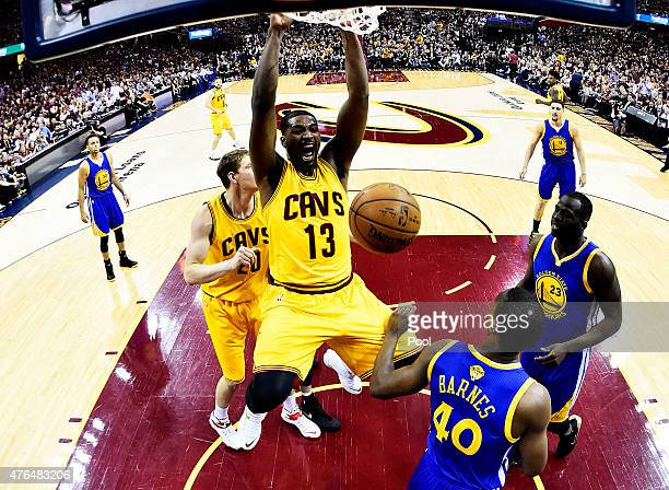 Tristan Thompson of the Cleveland Cavaliers dunks against Harrison Barnes of the Golden State Warriors in the first half during Game Three of the...