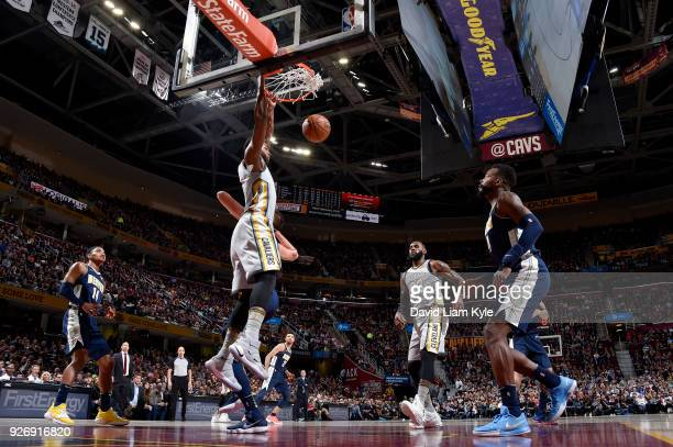 Tristan Thompson of the Cleveland Cavaliers dunks against the Denver Nuggets on March 3 2018 at Quicken Loans Arena in Cleveland Ohio NOTE TO USER...