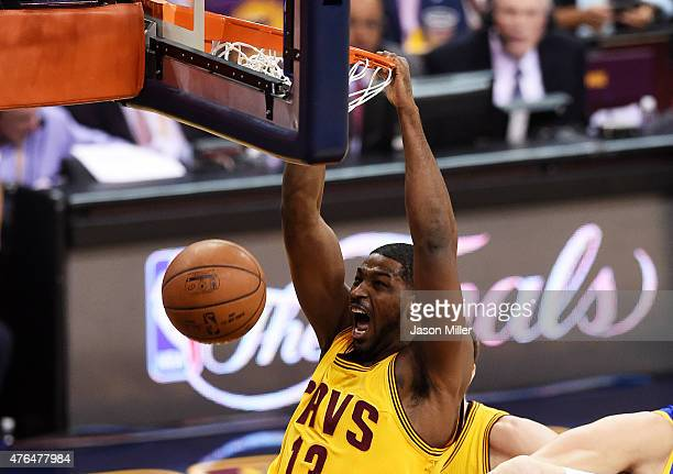 Tristan Thompson of the Cleveland Cavaliers dunks against the Golden State Warriors in the first quarter during Game Three of the 2015 NBA Finals at...