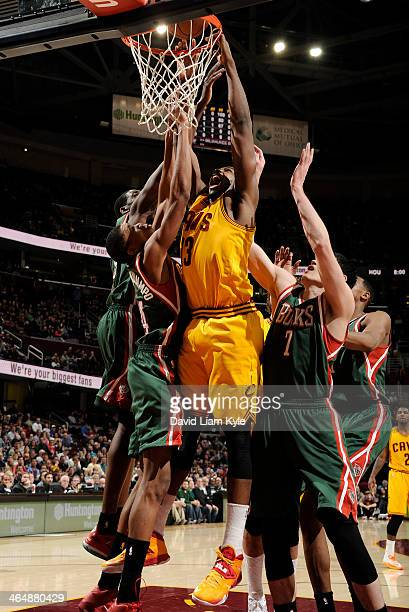 Tristan Thompson of the Cleveland Cavaliers dunks the ball against Giannis Antetokounmpo and Ersan Ilyasova of the Milwaukee Bucks at The Quicken...