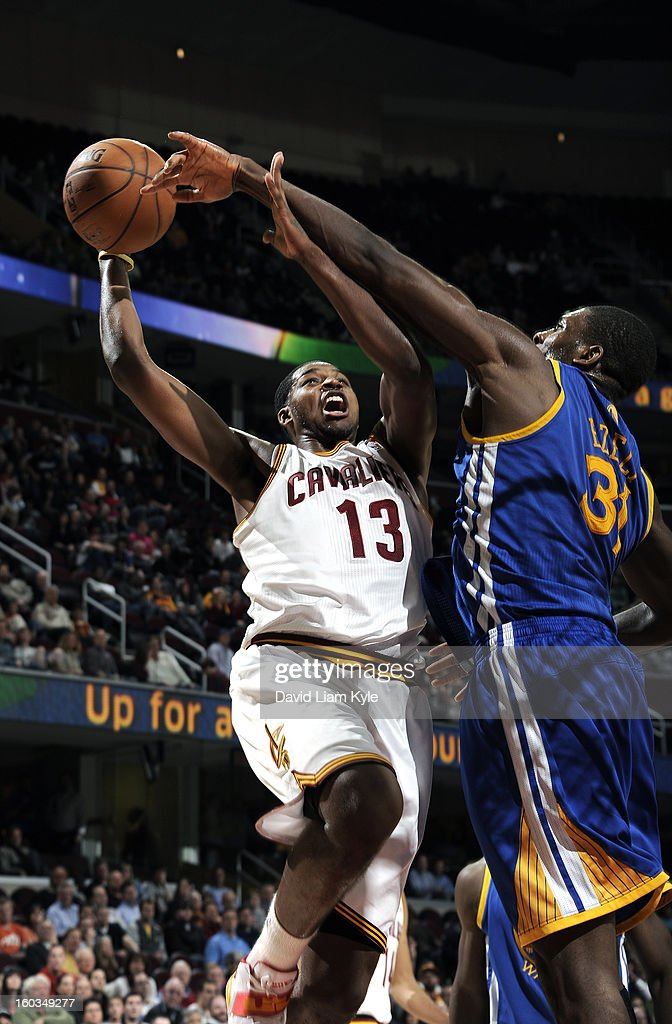 Tristan Thompson #13 of the Cleveland Cavaliers goes up for the shot against Festus Ezeli #31 of the Golden State Warriors at The Quicken Loans Arena on January 29, 2013 in Cleveland, Ohio.