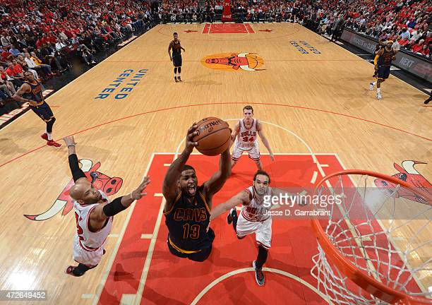 Tristan Thompson of the Cleveland Cavaliers goes up strong to the basket against the Chicago Bulls at the United Center During Game Two of the...