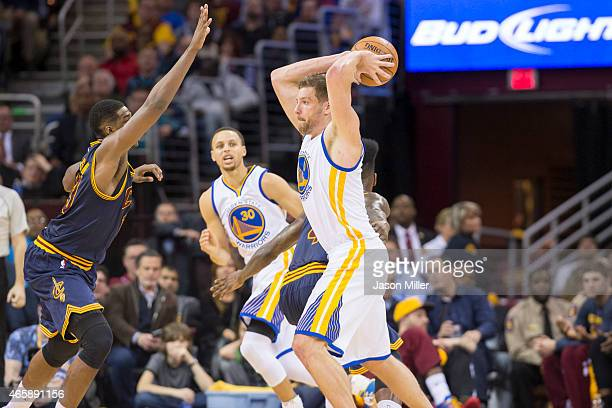 Tristan Thompson of the Cleveland Cavaliers guards David Lee of the Golden State Warriors during the second half at Quicken Loans Arena on February...