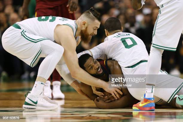 Tristan Thompson of the Cleveland Cavaliers is defended by Aron Baynes and Jayson Tatum of the Boston Celtics during the second quarter in Game One...