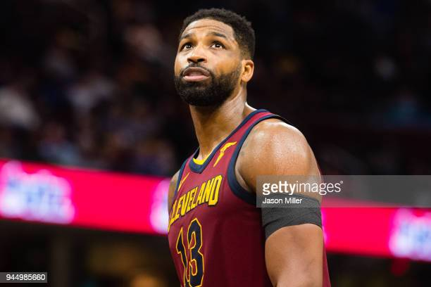 Tristan Thompson of the Cleveland Cavaliers looks to the scoreboard during the second half at Quicken Loans Arena on April 11 2018 in Cleveland Ohio...