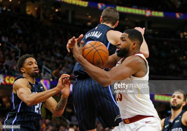 Tristan Thompson of the Cleveland Cavaliers pulls down a rebound against Khem Birch of the Orlando Magic at Quicken Loans Arena on January 18 2018 in...