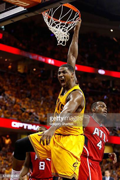 Tristan Thompson of the Cleveland Cavaliers reacts after a dunk in the third quarter against the Atlanta Hawks during Game Four of the Eastern...