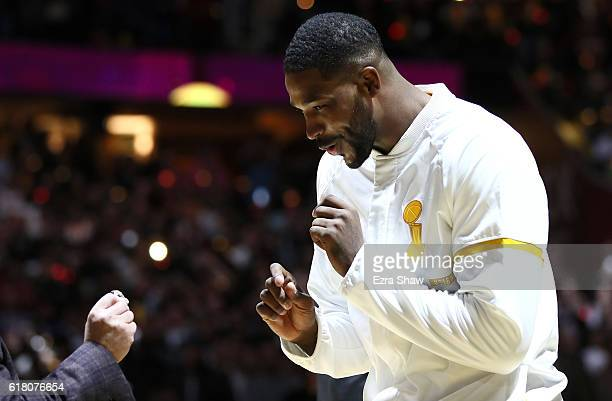 Tristan Thompson of the Cleveland Cavaliers receives his championship ring from owner Dan Gilbert before the game against the New York Knicks at...