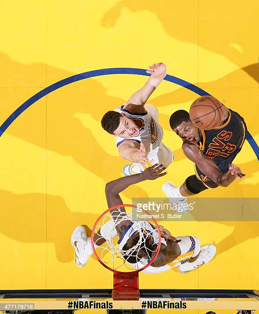 Tristan Thompson of the Cleveland Cavaliers shoots over Klay Thompson of the Golden State Warriors in Game Five of the 2015 NBA Finals on June 14...