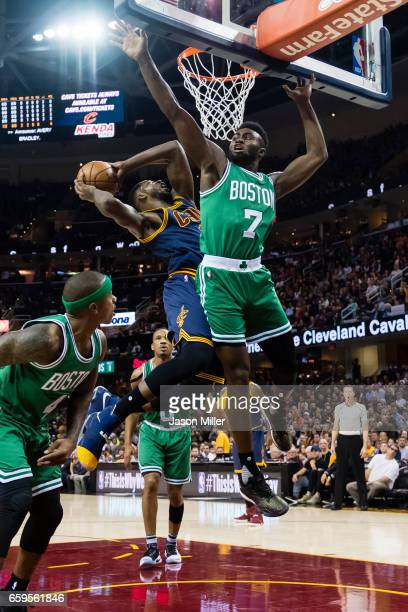 Tristan Thompson of the Cleveland Cavaliers shoots while Jaylen Brown of the Boston Celtics guards during the first half at Quicken Loans Arena on...