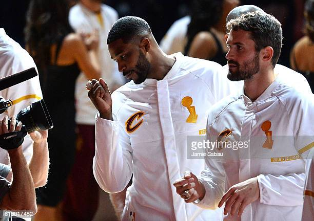 Tristan Thompson of the Cleveland Cavaliers shows his championship ring during a pre-game ceremony before the game against the New York Knicks at...