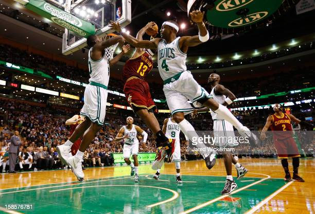 Tristan Thompson of the Cleveland Cavaliers splits Brandon Bass and Jason Terry of the Boston Celtics before dunking the ball during the game on...
